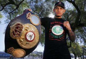 Jose Benavidez holding championship belt